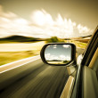 Car on the road wiht motion blur background. — Stock Photo