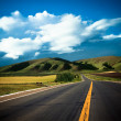 Road to the future with the mountain and blue sky background outdoor. — Stock Photo #9661586