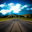 Stock Photo: Road to the future with the mountain and blue sky background outdoor.