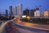 Traffic through downtown the lujiazui financial centre in shanghai china. — Stock Photo