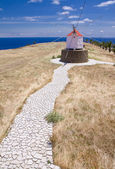 Footpath to Portuguese windmill — Stock Photo