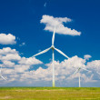 Stock Photo: Windmills with clouds