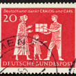 Postage stamp Germany 1963 Mother and Child Receiving Gift Parce — Stock Photo