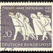 Postage stamp Germany 1965 Family in flight — Stock Photo