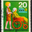 Postage stamp Germany 1970 Nurse Assisting Elderly Woman — Stock Photo
