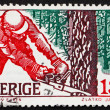 Stock Photo: Postage stamp Sweden 1979 Woodcutter in Winter