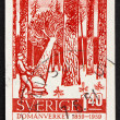 Stock Photo: Postage stamp Sweden 1959 Woodcutter in Forest