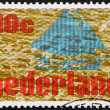 Postage stamp Netherlands 1976 Sailing Ship and City - Stock Photo