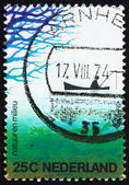 Postage stamp Netherlands 1974 Fisherman in Boat and Frog — Stock Photo