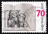 Postage stamp Netherlands 1991 Children Reading — Stock Photo