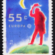 Postage stamp Netherlands 1991 Man and Moon - Stock Photo