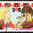 Postage stamp Netherlands 1980 Boy and Girl Inspecting Stamp — Stock Photo