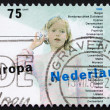 Postage stamp Netherlands 1989 Girl and String Telephone — Stock Photo