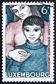 Postage stamp Luxembourg 1968 Orphan and Foster Mother — Stock Photo
