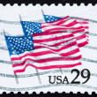 Stock Photo: Postage stamp USA 1981 US Flags on Parade