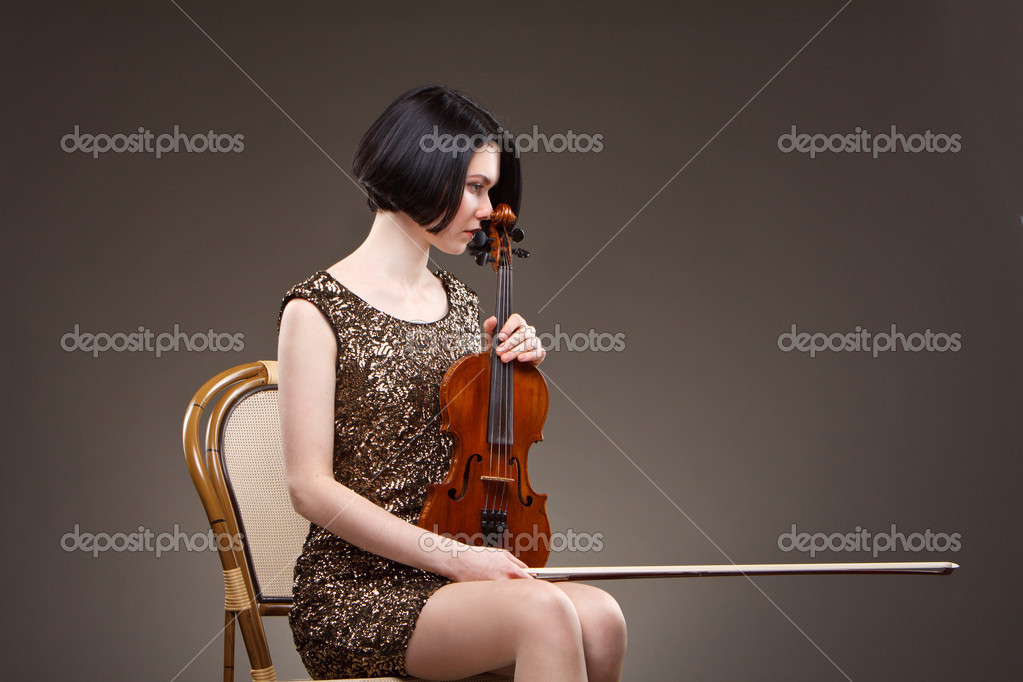 Girl with violin in gold dress  Stock Photo #10256369