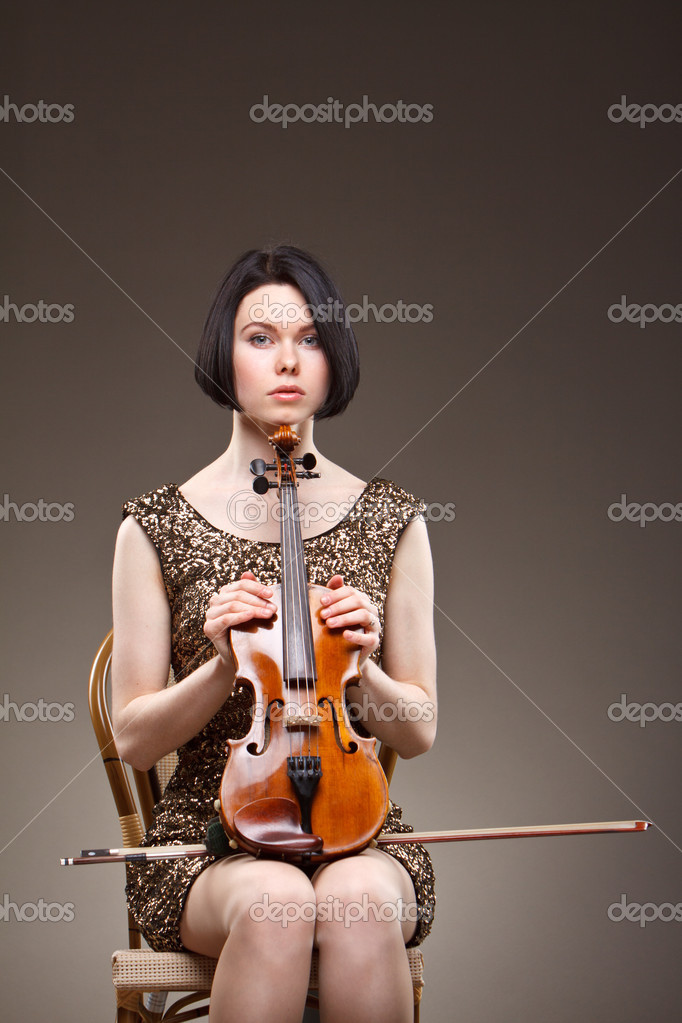 Girl with violin in gold dress — Stock Photo #10256719