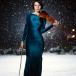 Girl with violin on snow — Stock Photo