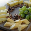 Set  cheese on a wooden board - Stock Photo