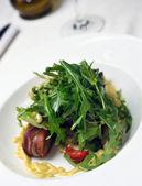 Salad with ham and arugula — Stock Photo