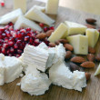 Set of goat cheese on a wooden board — Stock Photo