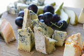 Set of cheese with mold on a wooden board — Stock Photo