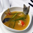Fish soup with saffron - Stock Photo