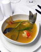 Fish soup with saffron — Stock Photo