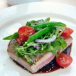 Grilled tuna with vegetables and sauce - Stock Photo
