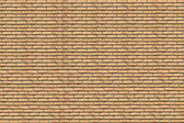 一个背景。黄砖壁 — 图库照片