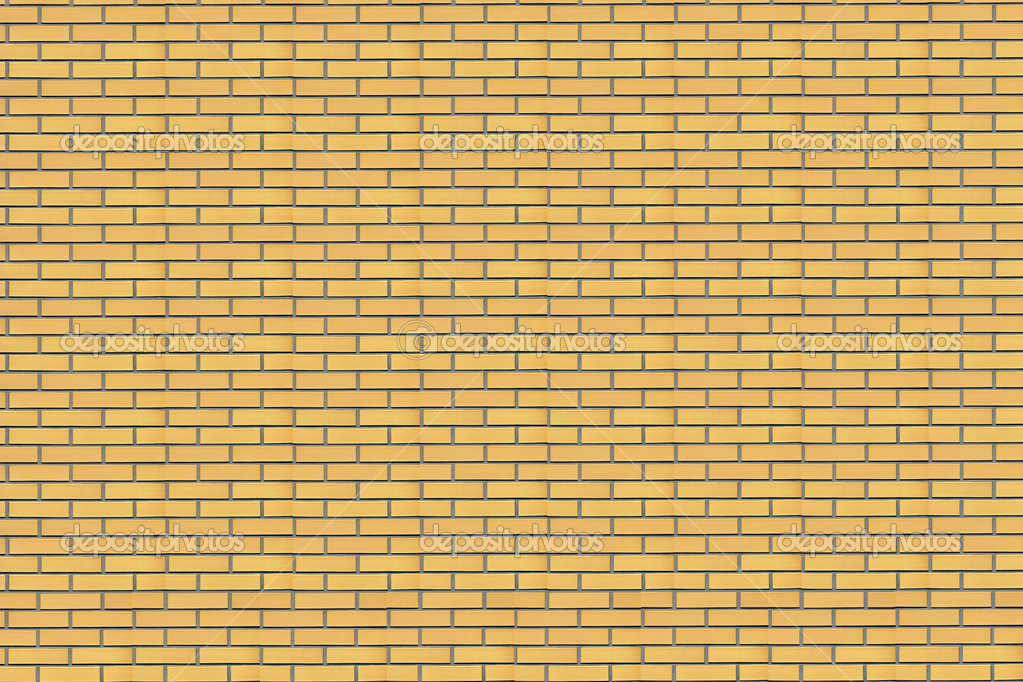 Wall of a house from a yellow brick. A background  Stock Photo #10368630