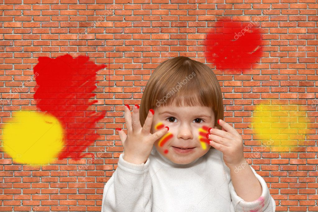 The soiled small girl. Wall of a house from a red brick — Stock Photo #10368867