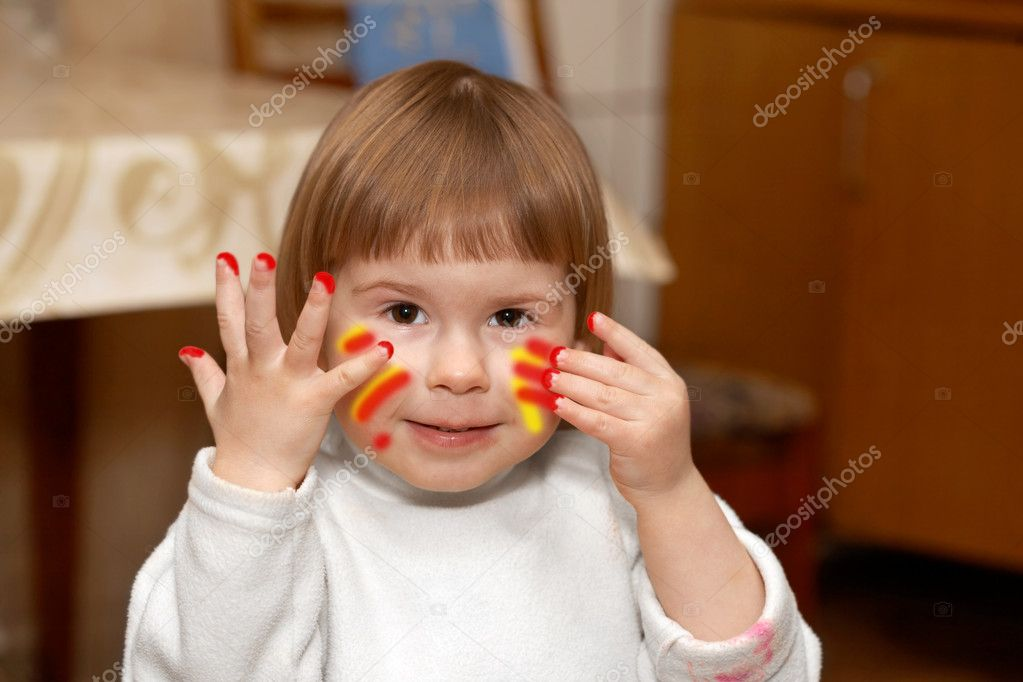 The small girl with the soiled hands in a room  Stock Photo #10371956