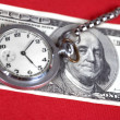 The dollars and clock — Stock Photo