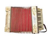 Antiguo instrumento musical acordeón sucio aislado en blanco — Foto de Stock