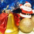 Christmas composition with Santa, bell, and golden bulbs — Stock Photo