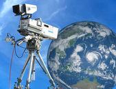 TV Professional studio digital video camera over blue sky and Ea — Stock Photo
