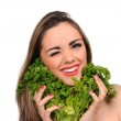 Portrait of beautiful girl with green parsley — Stock Photo
