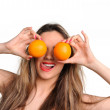 Young smiling sexy woman with orange fruits — Stock Photo
