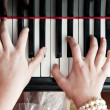 Hands on piano keys — Stock Photo