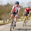 Cyclists in a curve - Stock Photo