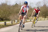 Cyclists in a curve — Stock Photo