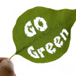 Go green message on a leaf — Stock Photo