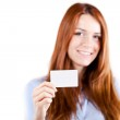 Portrait of an atractive young business woman presenting a business card — Stock Photo
