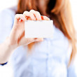portrait of an atractive young business woman presenting a business card — Stock Photo #10513723