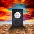 Speaker in desert land — Stock Photo