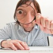 Businessman with magnifying glass — Stock Photo #8161161