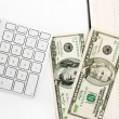 Keyboard and dollars — Stock Photo