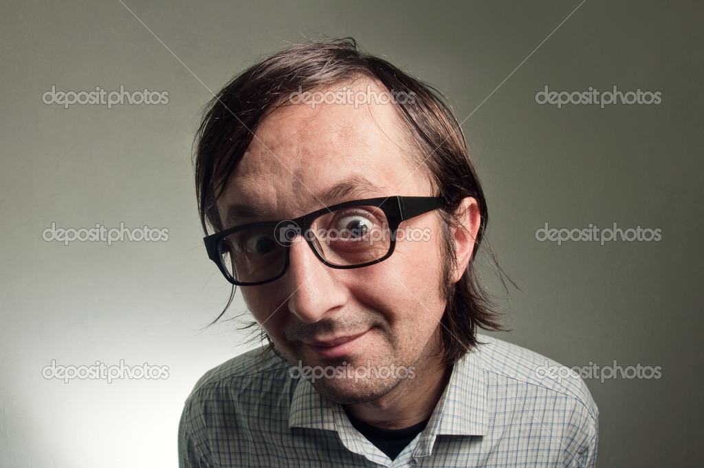 Big head nerd male close up portrait, this image is a humorous concept photo.  Zdjcie stockowe #8729789