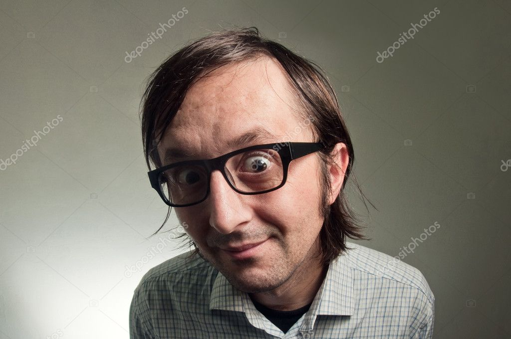 Big head nerd male close up portrait, this image is a humorous concept photo.  Foto de Stock   #8729789